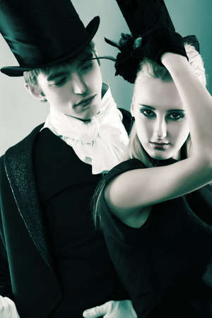 cosplay: Portrait of the elegant young couple in 18, 19th century costumes. Shot in a studio.