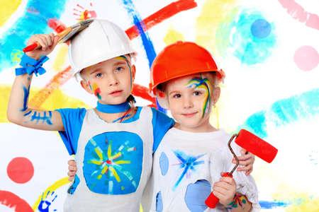 Two beautiful children enjoying their painting. Education. Stock Photo - 6505195