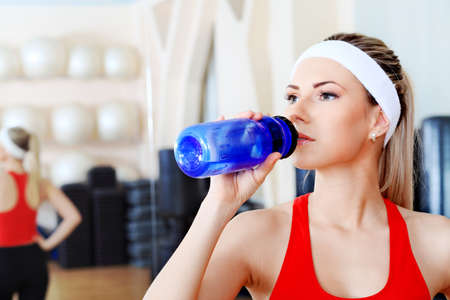 Young sporty woman in the gym centre. Stock Photo - 6505192