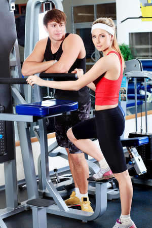 Couple of a sporty young people in the gym centre. Stock Photo - 6505165