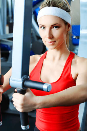female form: Young sporty woman in the gym centre.