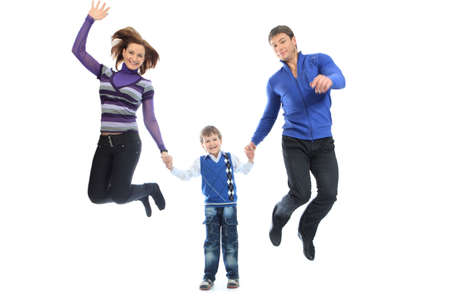 Portrait of a happy family jumping together. Isolated over white background. photo