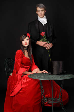 Portrait of a beautiful couple in medieval costumes with vampire style make-up. Shot in a studio. Stock Photo - 6546803