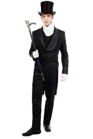 cosplay: Portrait of a young gentlemen wearing dinner jacket and black top hat. Shot in a studio.