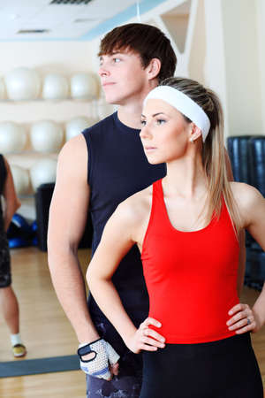 sporty: Couple of a sporty young people in the gym centre. Stock Photo