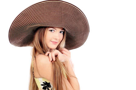 Portrait of a beautiful girl in a summer hat. Isolated over white background. Stock Photo - 6560211