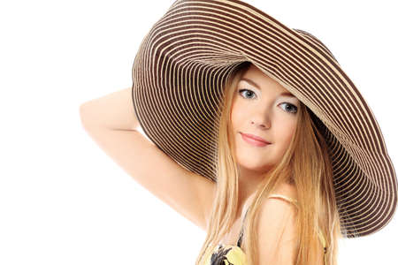 Portrait of a beautiful girl in a summer hat. Isolated over white background. Stock Photo - 6560282