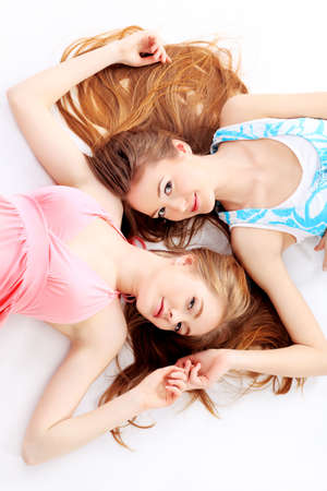 Two happy girls friends. Isolated over white background. Stock Photo - 6560230
