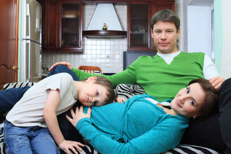 Happy family with a child at home. photo