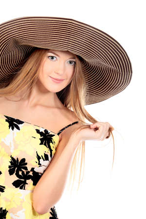 Portrait of a beautiful girl in a summer hat. Isolated over white background. photo
