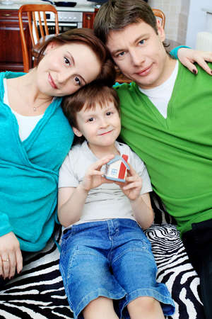 Happy family with a child at home. Stock Photo - 11692273