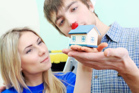hypothec: Happy family at their new home. Stock Photo
