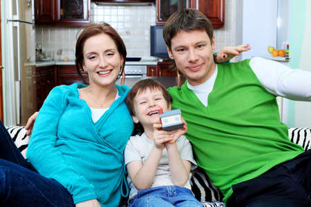 Happy family with a child at home. Stock Photo - 11692203