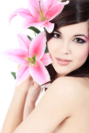 Shot of a young beautiful woman with a lily flowers. Isolated over white background. photo