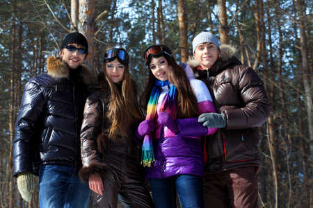 Group of young people having a rest outdoor in winter. Stock Photo - 6681406