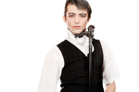 Portrait of a handsome young man with vampire style make-up. Shot in a studio. photo
