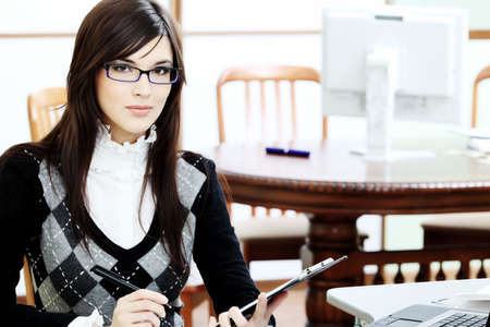 education success: Business theme: beautiful businesswoman working at the office.