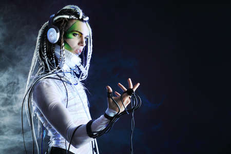 Shot of a futuristic young man in headphones and with wires. photo