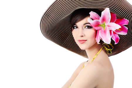 Shot of a young beautiful woman in elegant hat with a lily flowers. Isolated over white background. photo