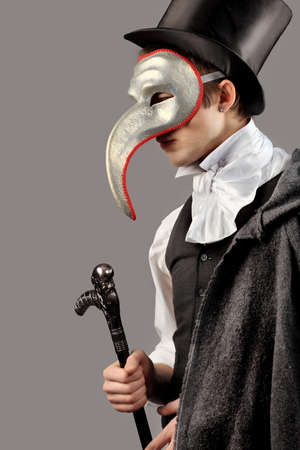 dinner jacket: Portrait of a young gentlemen wearing masquerade costume. Shot in a studio.