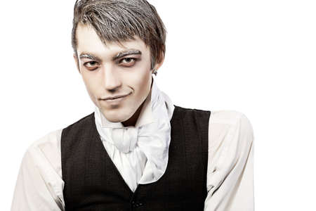 cosplay: Portrait of a handsome young man with vampire style make-up. Shot in a studio. Stock Photo