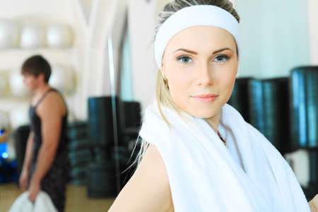 wellness center: Couple of a sporty young people in the gym centre. Stock Photo