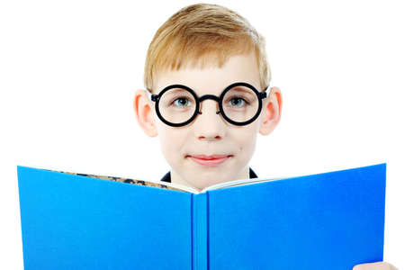 Portrait of a boy in a funny glasses holding a book. Isolated over white background. photo