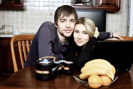 mealtime: Happy young couple having a rest at home. Stock Photo