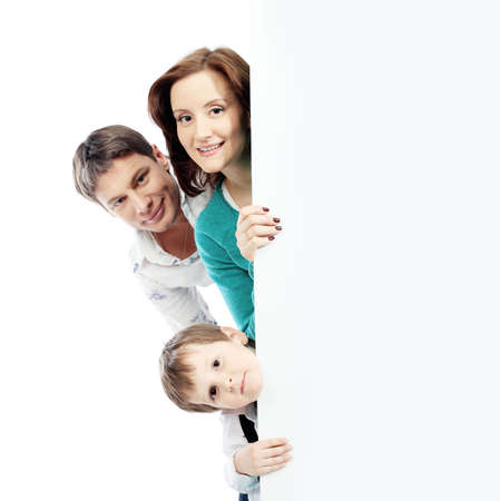 Portrait of a happy family looking out of a billboard. Isolated over white background. photo