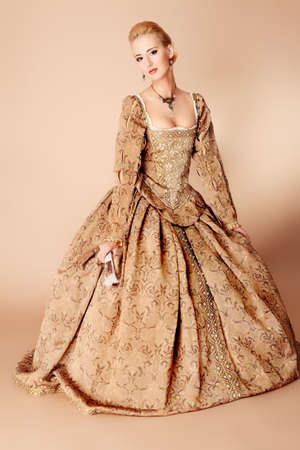 Portrait of a beautiful woman in medieval era dress. Shot in a studio. Stock Photo