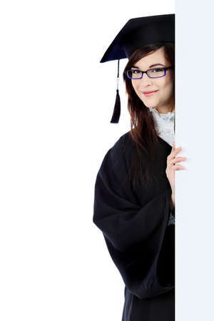 achiever: Educational theme: graduating student girl in an academic gown holding a billboard. Isolated over white background.