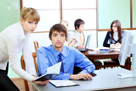 Group of business people interacting together at the office. Stock Photo - 6798961