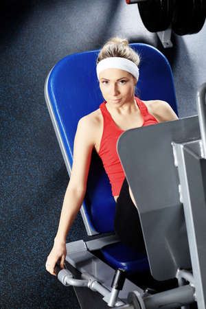 Young sporty woman in the gym centre. photo