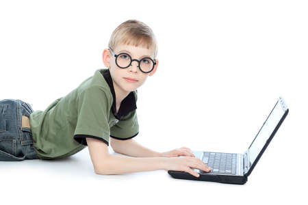 Shot of a boy lying on a floor with her laptop. Isolated over white background. photo