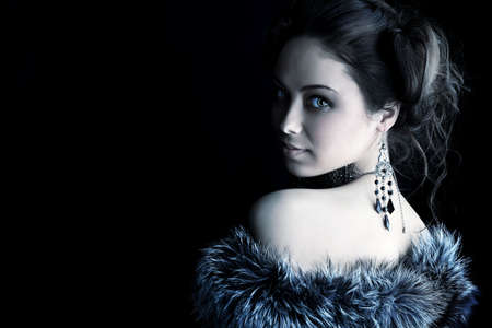 Portrait of a beautiful woman over black background.. photo