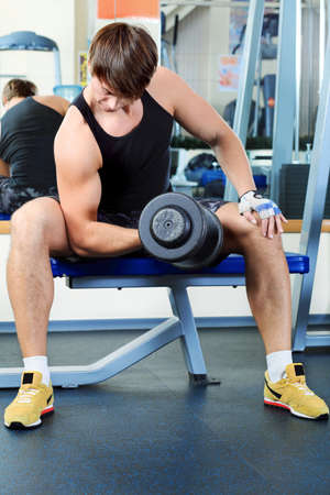 Sporty man in the gym centre. Stock Photo - 11692061