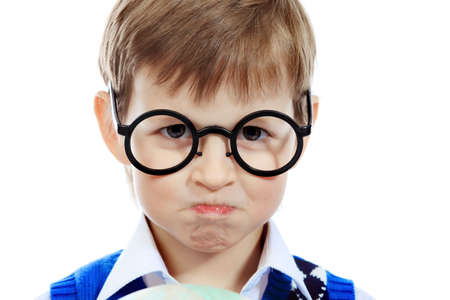 angry kid: Portrait of a little boy in a funny glasses. Isolated over white background.