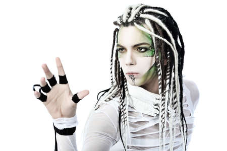 Shot of a futuristic young man with wires. Isolated over white background. photo