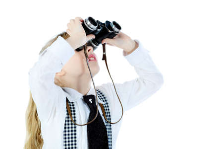 Shot of a girl looking up through a binocular. Isolated over white background. photo