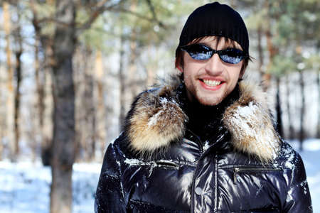 Portrait of a handsome man outdoor in winter. photo