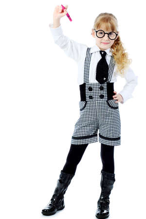 Shot of a little girl in glasses with a pen in her hand. Isolated over white background. Stock Photo - 6864574