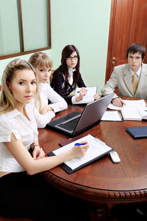 Group of business people interacting together at the office. Stock Photo - 6864774