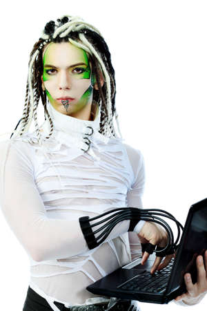 Shot of a futuristic young man with wires holding a laptop. Isolated over white background. Stock Photo - 6869578