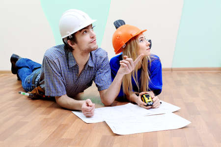 home renovations: Happy family making repairs at their new home.