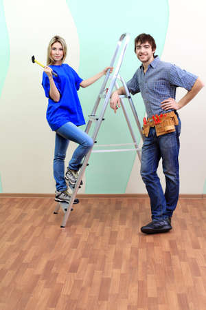 repairs: Happy family making repairs at their new home.