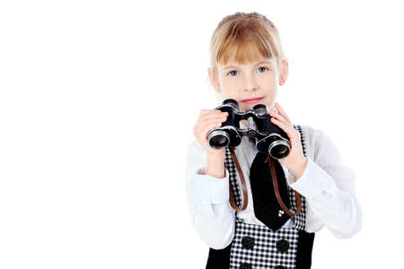 Shot of a girl with a binocular. Isolated over white background. photo