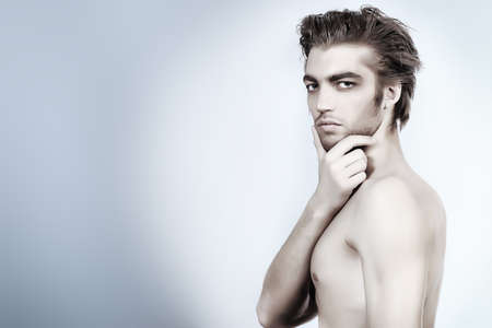 the seducer: Portrait of a handsome muscular young man. Shot in a studio. Stock Photo