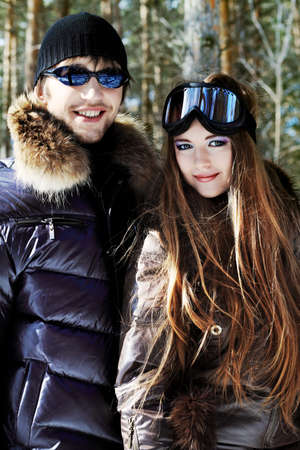 Portrait of a happy young couple having a rest in winter park. Stock Photo - 6939583