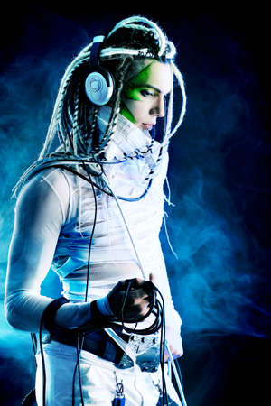 Shot of a futuristic young man with wires. photo