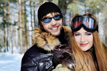 Portrait of a happy young couple having a rest in winter park. Stock Photo - 6939573